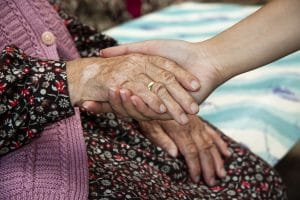 Holding elderly ladies hand